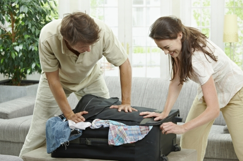 Couple packing for a holiday