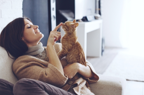 Woman petting her cat.