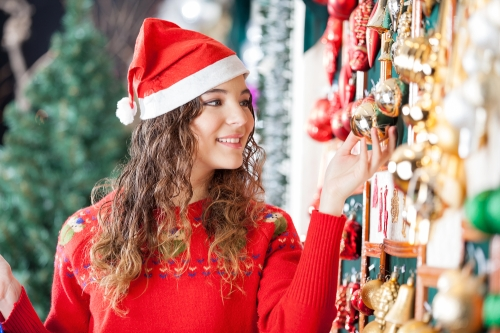 Woman buying Christmas ornaments