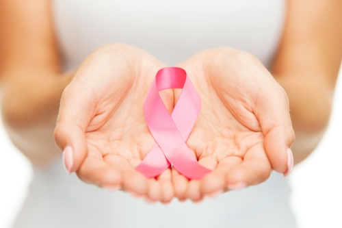 Woman holding the pink ribbon.