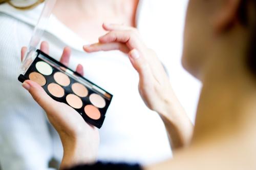 Woman choosing foundation color.