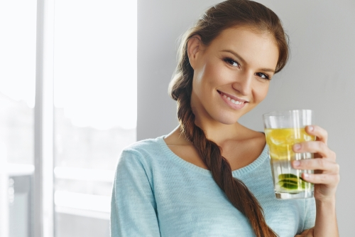 Woman drinking detox water