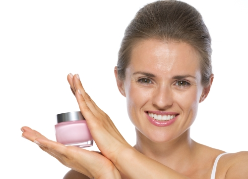 Woman holding a face cream