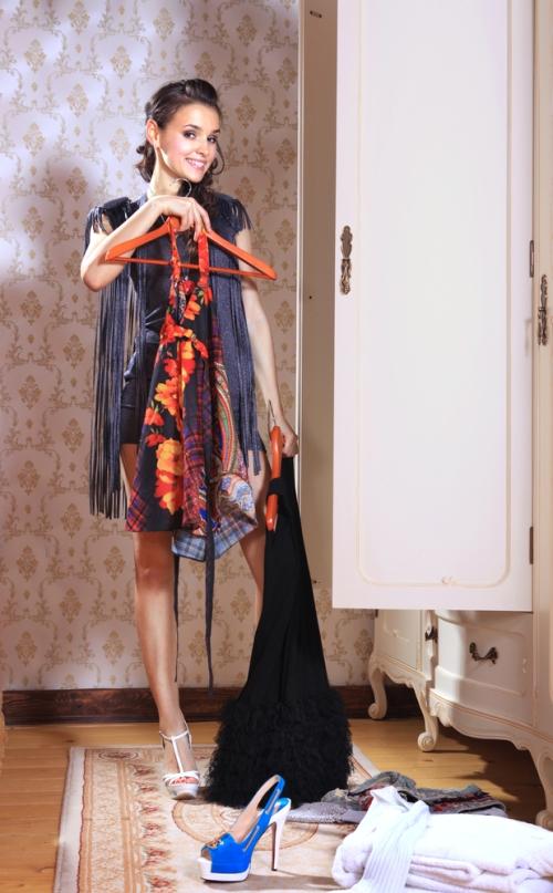 Woman decluttering her wardrobe