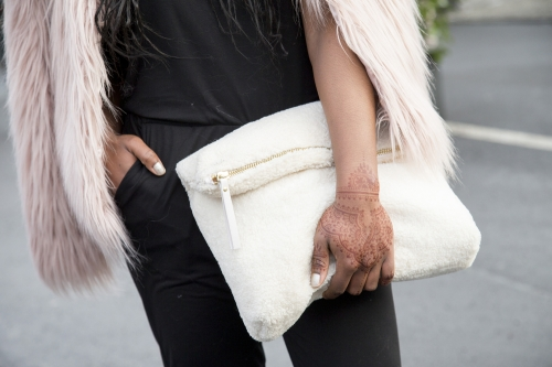 Woman holding a white bag