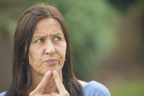 Woman pointing out her wrinkles