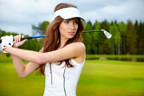 Woman wearing golf cap