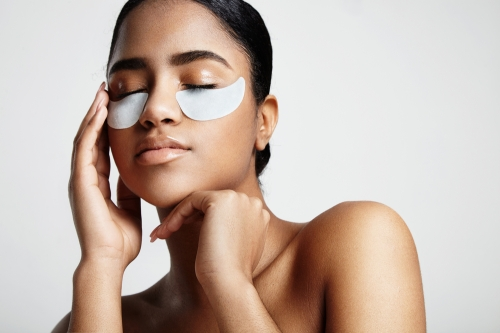 Woman applying eye mask