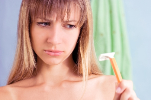 Woman looking at a razor