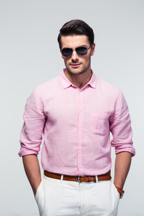 Man wearing pink shirt and neutral pants