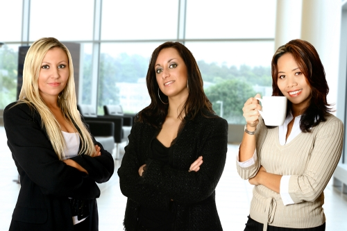 Businesswoman standing in office showing professionalism look