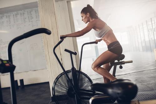 woman working on a stationary bike
