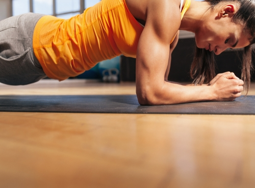 Woman completing a plank push up