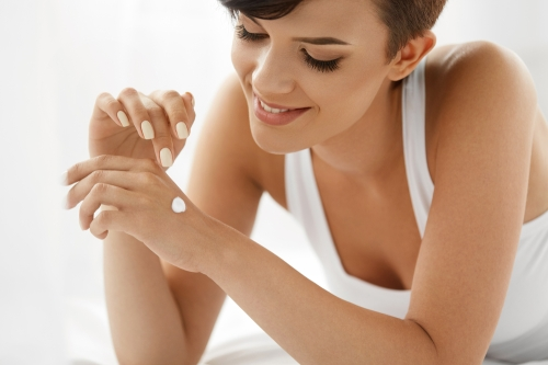 woman using lotion