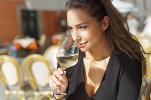 Woman holding a glass of sparkling wine