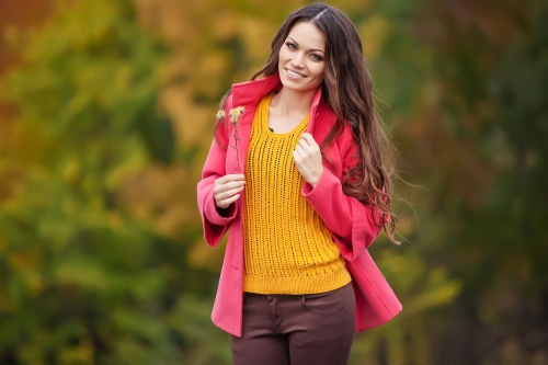 woman with brightly colored jacket