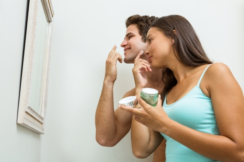 Couple using skincare together