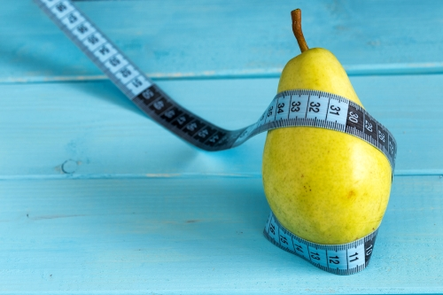 Pear wrapped with a measurement tape