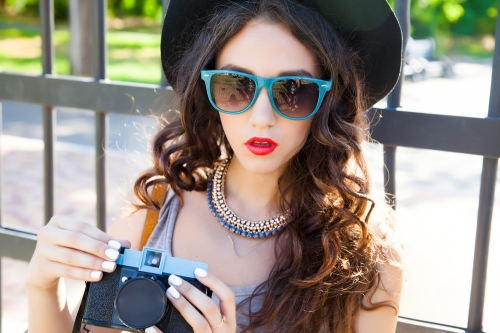 Woman with shades and red lips