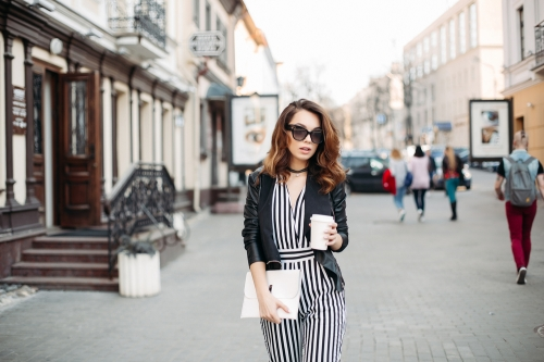 Woman in stripes, walking