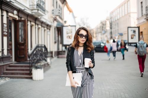 Woman in stripes, walking