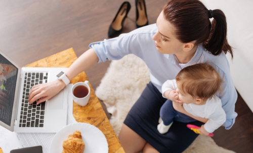 Woman working with toddler