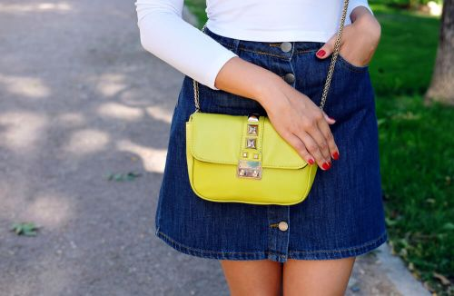 denim skirt and yellow purse