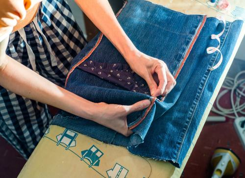 woman sewing denim